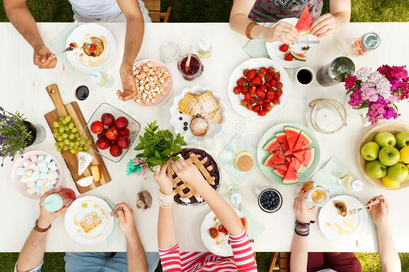 Young people sharing food stock image