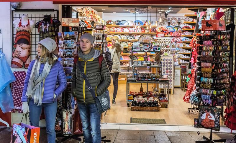 Young People shopping. People in the sales looking at store royalty free stock photography