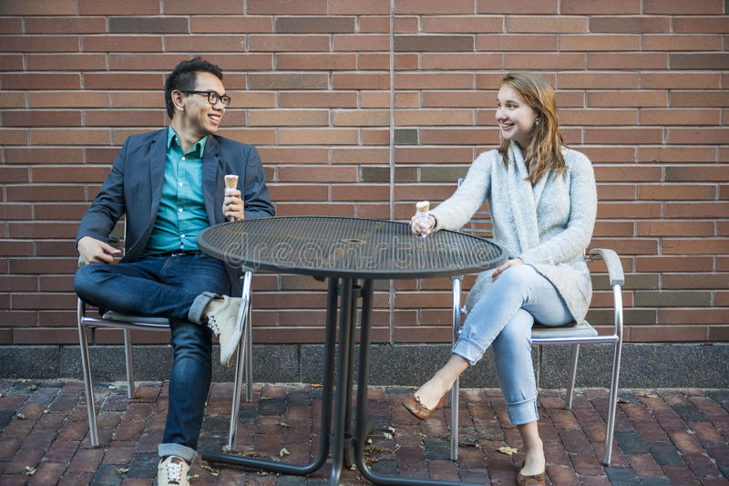Young people sitting on patio royalty free stock photo