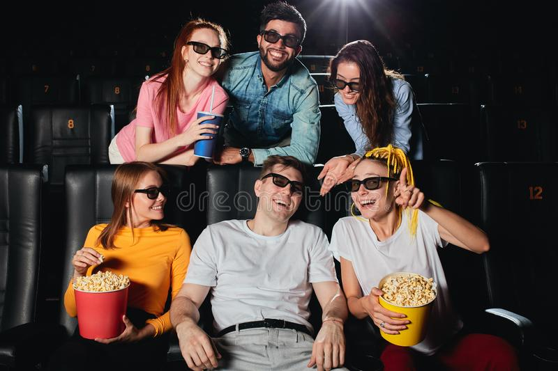 Young people spending great weekend at the cinema royalty free stock photo