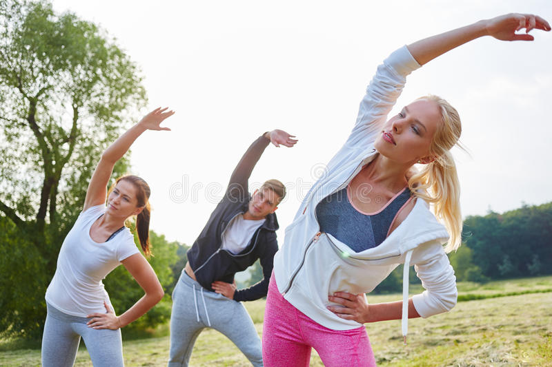 Young people stretching royalty free stock photos