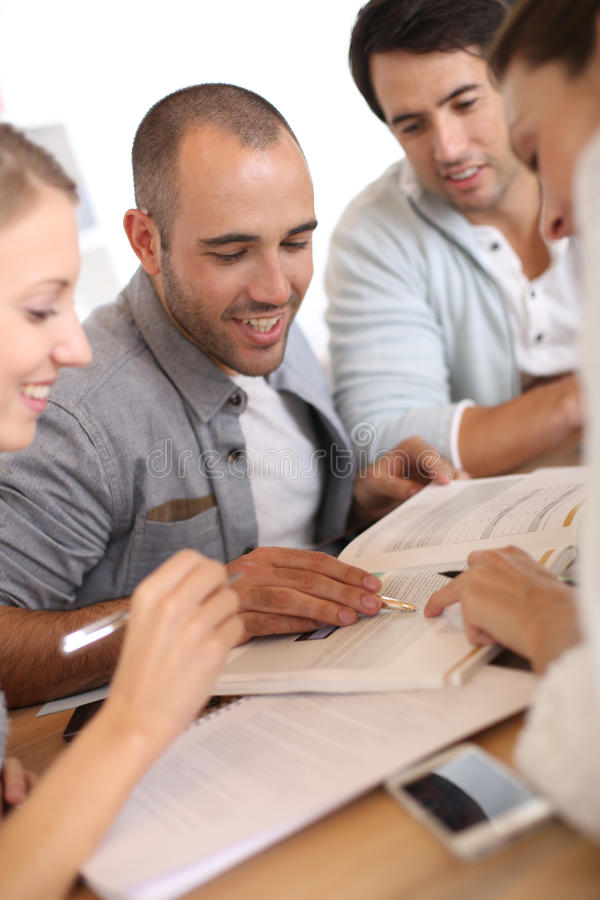 Young people studying together stock images