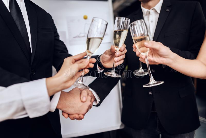 Young people in suits wear alcoholic drinks after a business meeting. stock photography