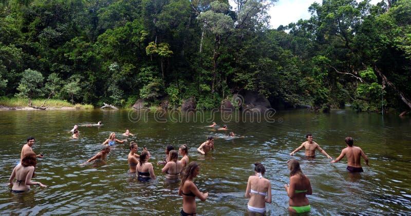 Young people swim in Babinda Boulders in Queensland Australia. CAIRNS, AUS - APR 21 2016:Young people swim in Babinda Boulders an iconic Cairn attraction and stock image