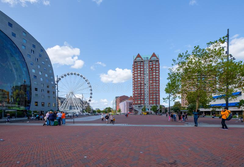 Young people take a picture of the famous market hall and Ferris wheel next to the building in Rotterdam, the Netherlands. royalty free stock photos