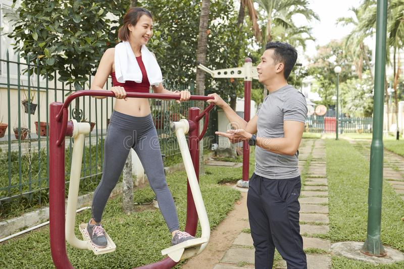 Young people talking and exercising in park royalty free stock photos