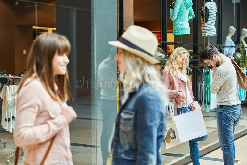 Young people are talking in the shopping mall stock images