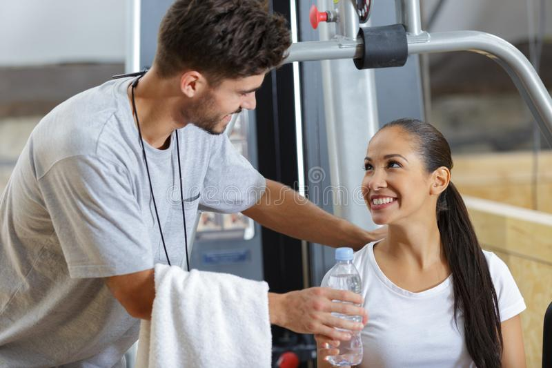Young people talking in gym while working out stock photos