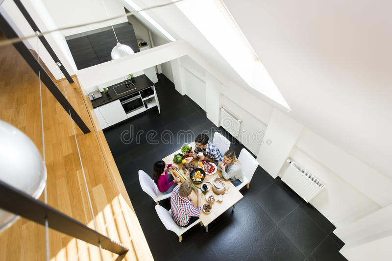Young people at the teble. Group of oung people eating pizza and drinking cider in the modern interior view from above royalty free stock photos