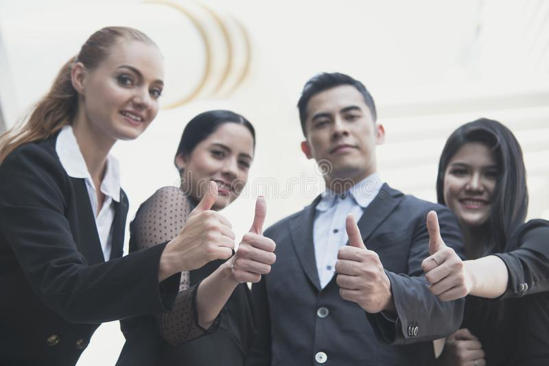 Young people thumbs up together. concept teamwork and success royalty free stock image