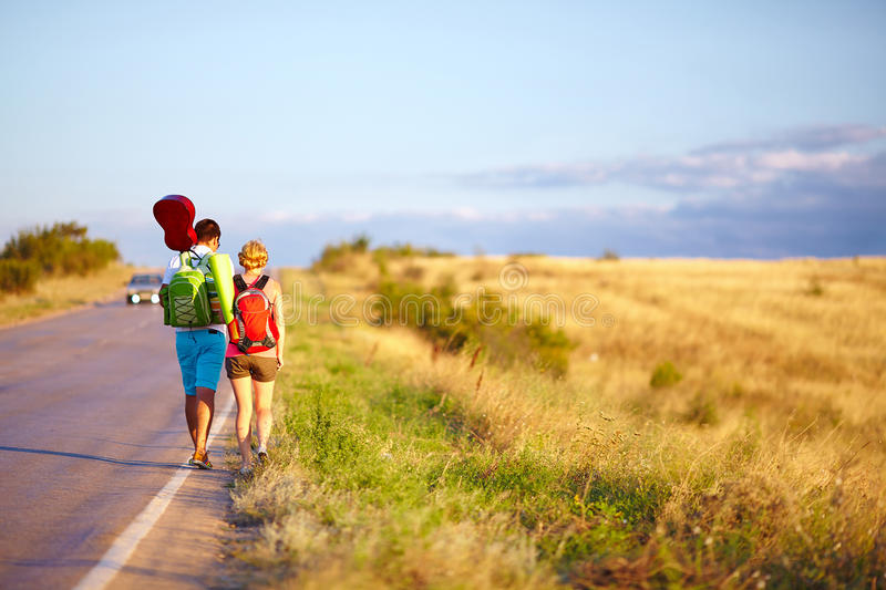 Young people traveling hitchhiking. summer stock photos