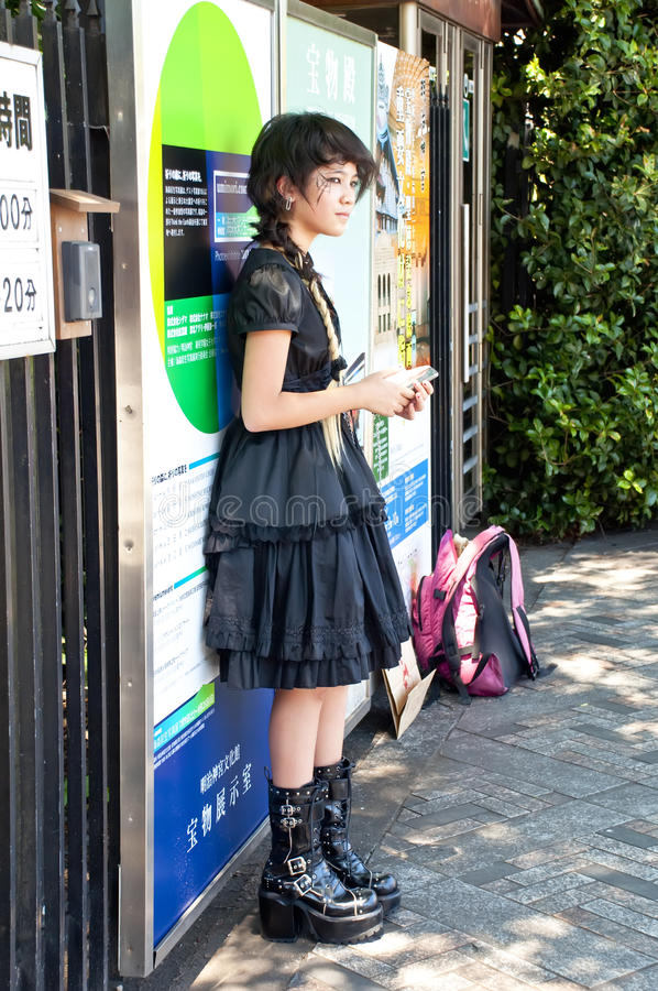 Young people with unique fashion styles. TOKYO, JAPAN - JULY 10: Unidentified people dressed in Harajuku district on July 10, 2011 in Tokyo, Japan. It is known stock image