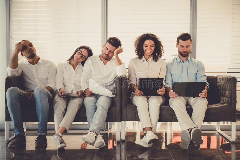 Young people waiting for interview royalty free stock photos