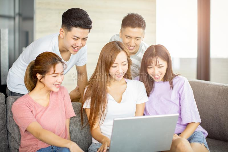 Young people watching the laptop on the couch royalty free stock photography