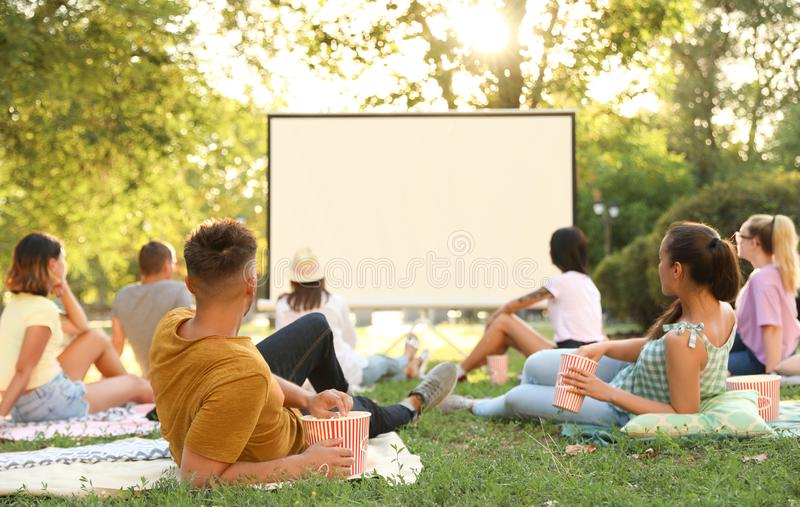 Young people watching movie in open air cinema royalty free stock photos