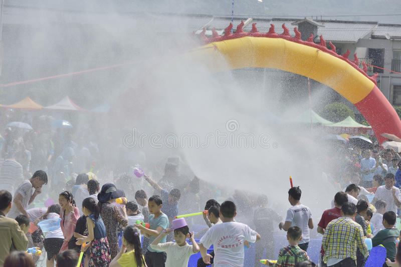 Young people in a water fight. Water-sprinkling festival activities in the May 1st Labour Day holiday!The location: shaonvping, shuifu, yunnan, china!Time stock photos