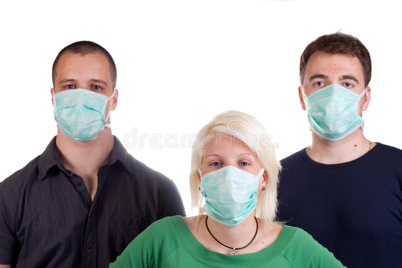 Young people wearing flu masks royalty free stock image