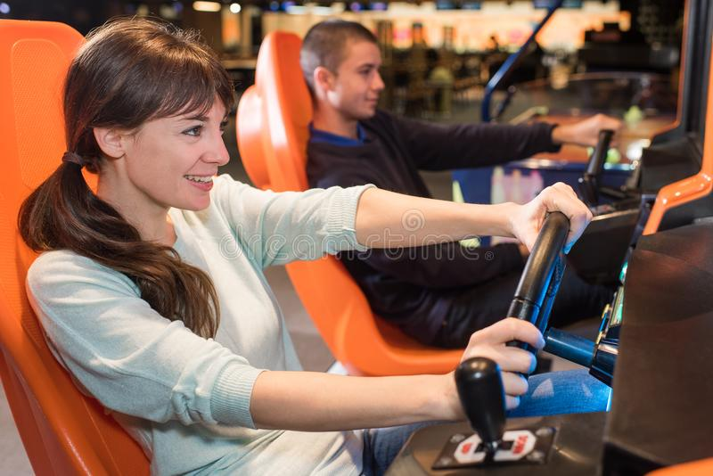 Young people at wheel arcade games stock image