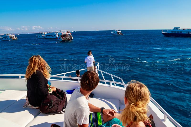 Young people on white yacht looking on Red sea. Young people on white yacht looking on the Red sea royalty free stock image