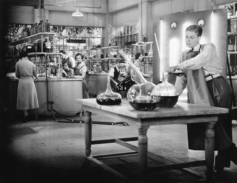 Young people working in a chemistry lab stock images