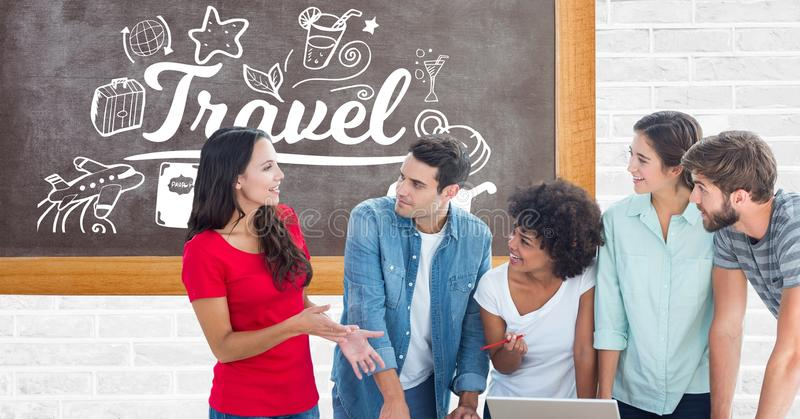 Young people working on laptop while standing against travel text and symbols on board stock images