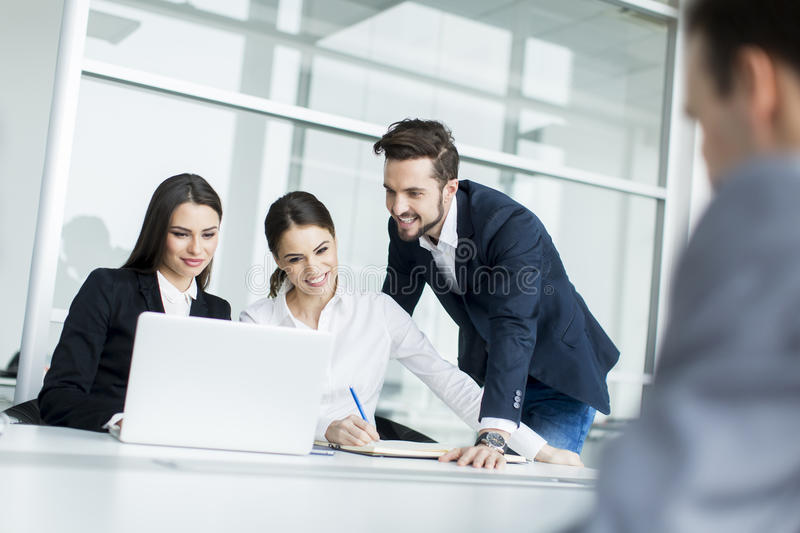 Young people working in the office stock photos