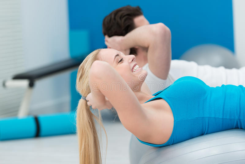 Young people working out at the gym stock photo