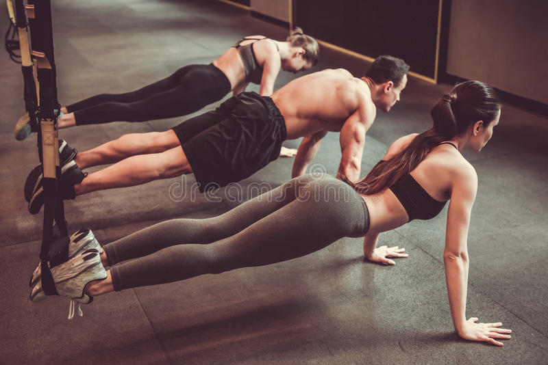 Young people working out with TRX royalty free stock photos