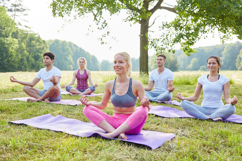 Young people in yoga workshop royalty free stock photography