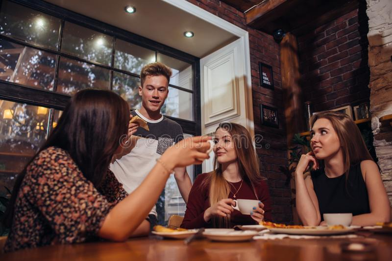 Young peoples having a coffee break relaxing and discussing royalty free stock photos