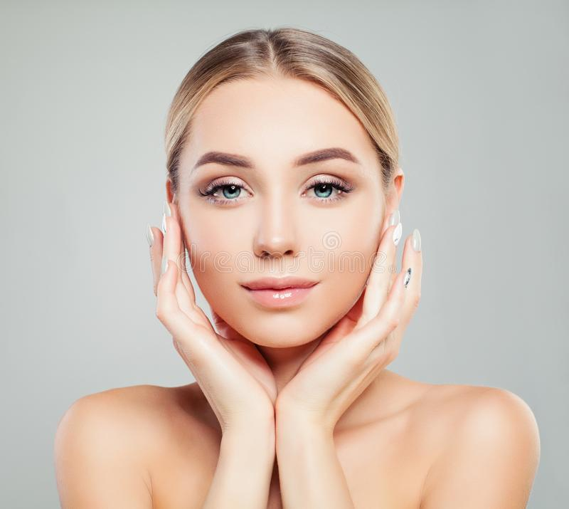 Young perfect female face. Perfect girl with healthy skin. Facial treatment, skincare and cosmetology concept stock image