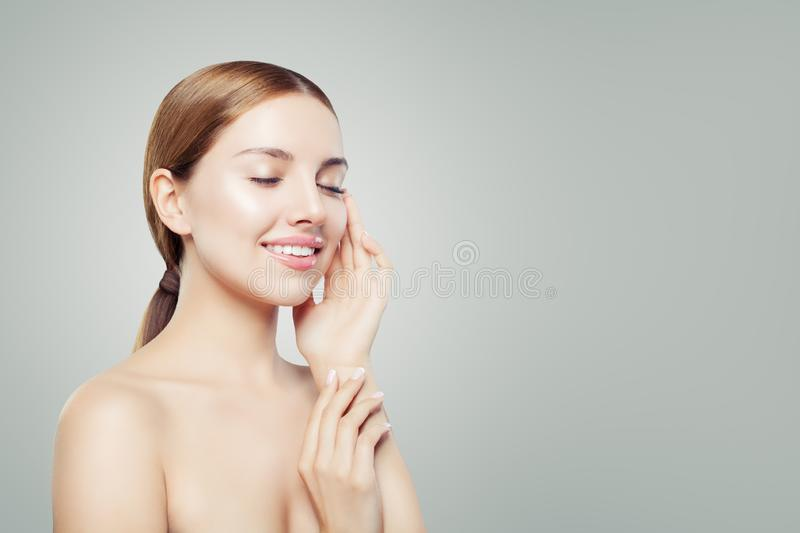 Young perfect girl relaxing. Beautiful girl with healthy skin, eyes closed. Facial treatment, skincare and cosmetology concept royalty free stock photo