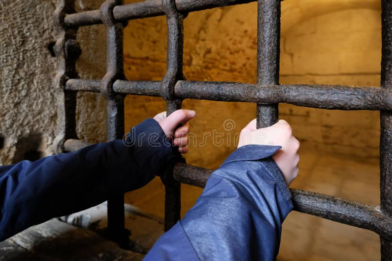 Young person behind bars stock photo