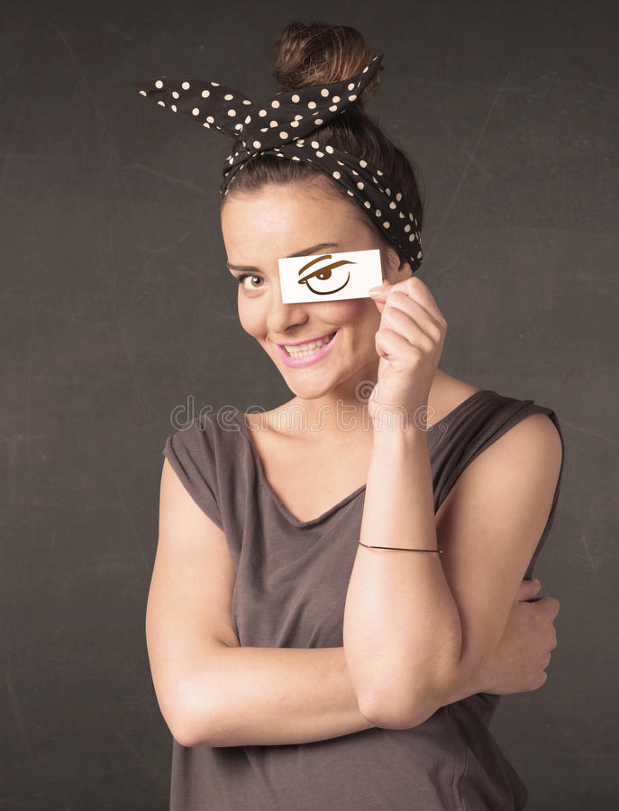 Young person holding paper with angry eye drawing. Concept royalty free stock photos