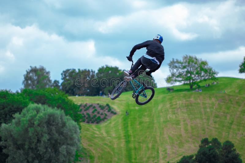 Young person is jumping with his bmx stock photography