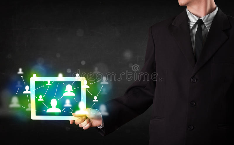 Young person presenting tablet with green social media icons royalty free stock images