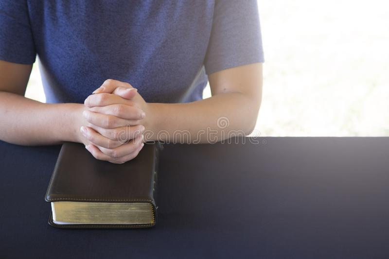 Young Person Studing the Bible and Praying royalty free stock photography