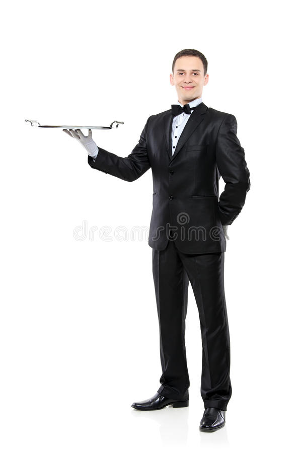 Young person in a suit holding an empty tray royalty free stock photos