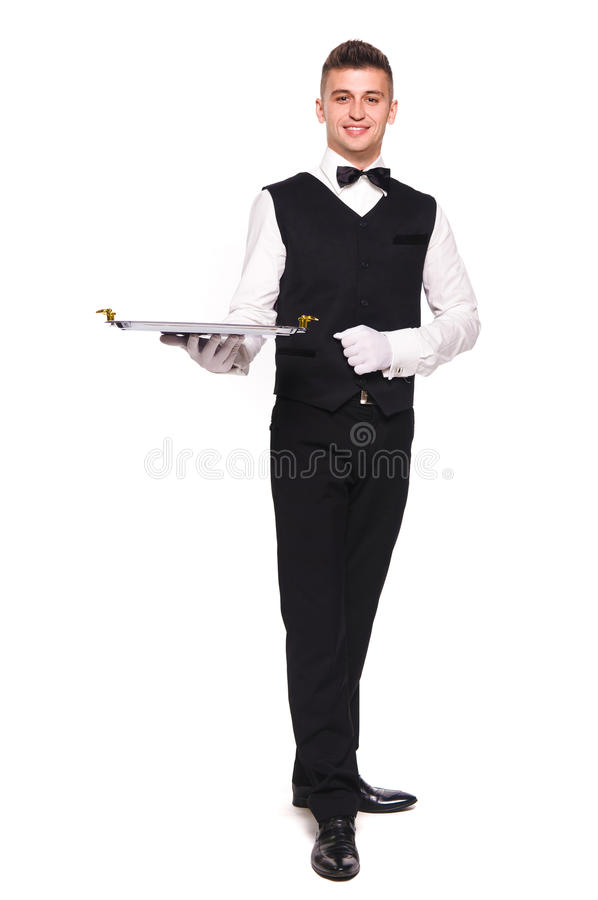 Young person in a suit holding an empty tray isolated on white b stock photo