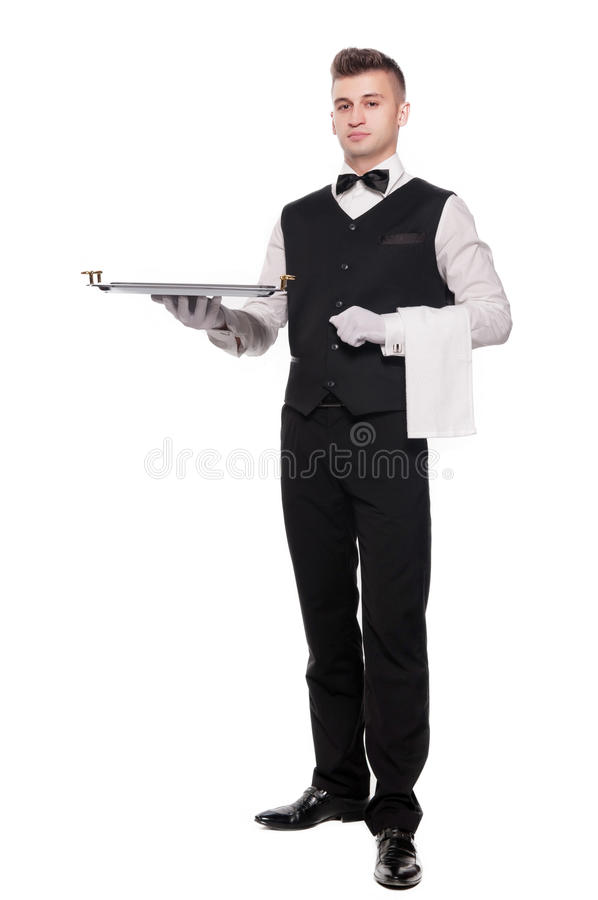 Young person in a suit holding an empty tray isolated on white b royalty free stock photography