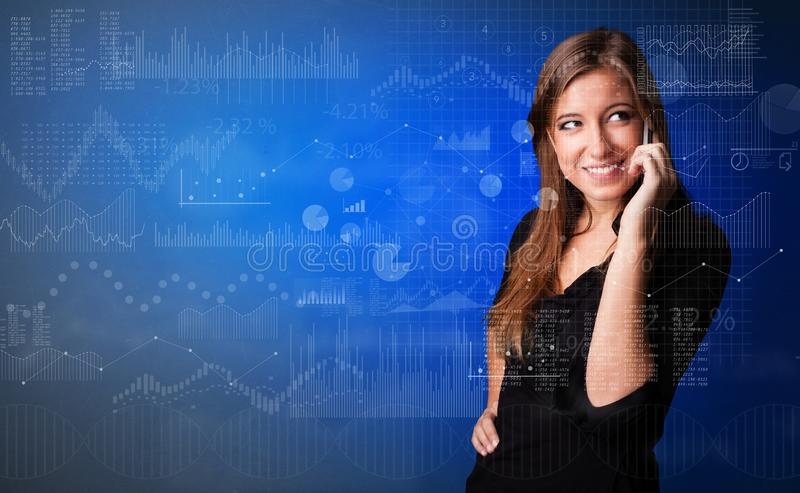 Person talking on the phone with chart and report in the foreground stock photo