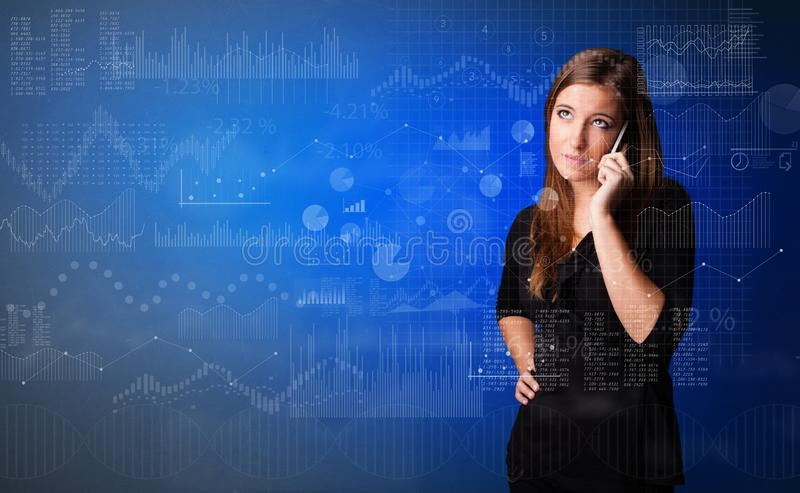 Person talking on the phone with chart and report in the foreground royalty free stock photography