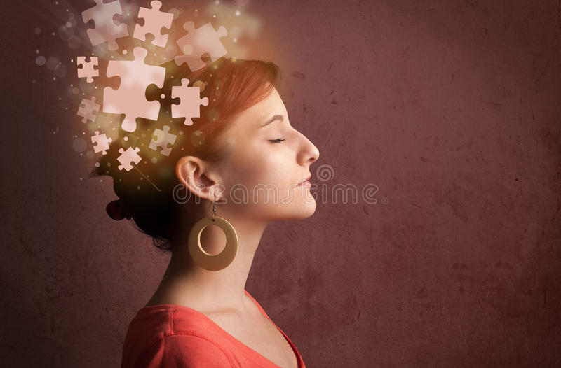Young person thinking with glowing puzzle mind royalty free stock image