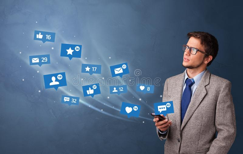 Young person using phone with social media concept stock photos