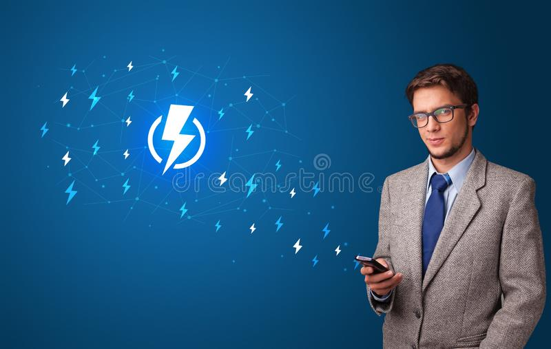 Person using phone with power concept stock photos