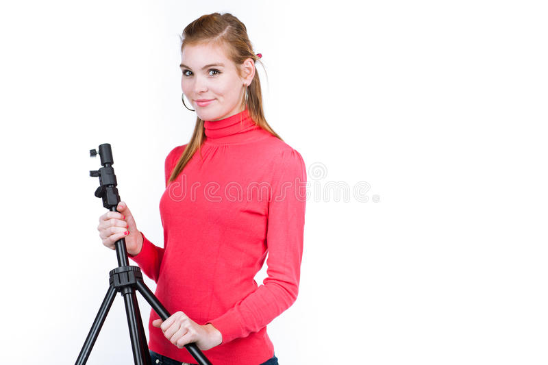 Young photo assistent. Photo studio concept: young model/photo assistent helping to set up the studio royalty free stock images