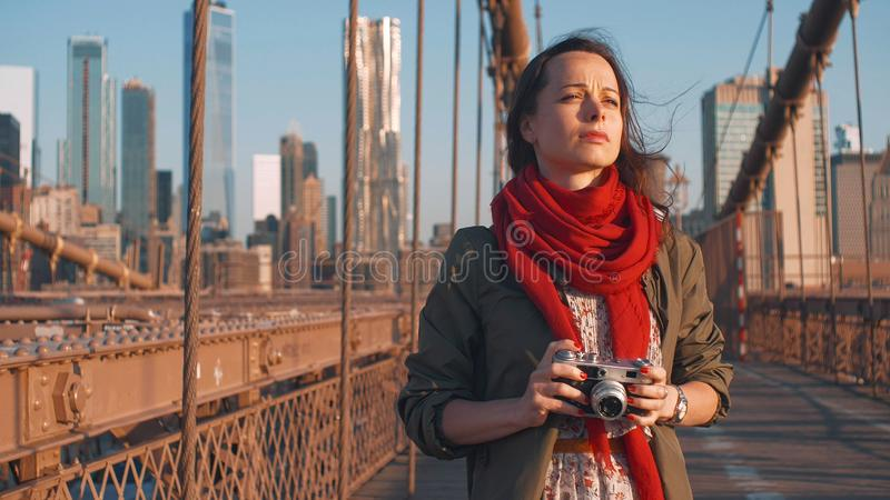 Young photographer on the Brooklyn Bridge in NYC. Young photographer on the Brooklyn Bridge in New York City stock photos