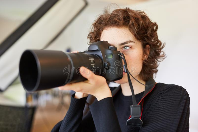 Young photographer photographed with digital camera stock photography