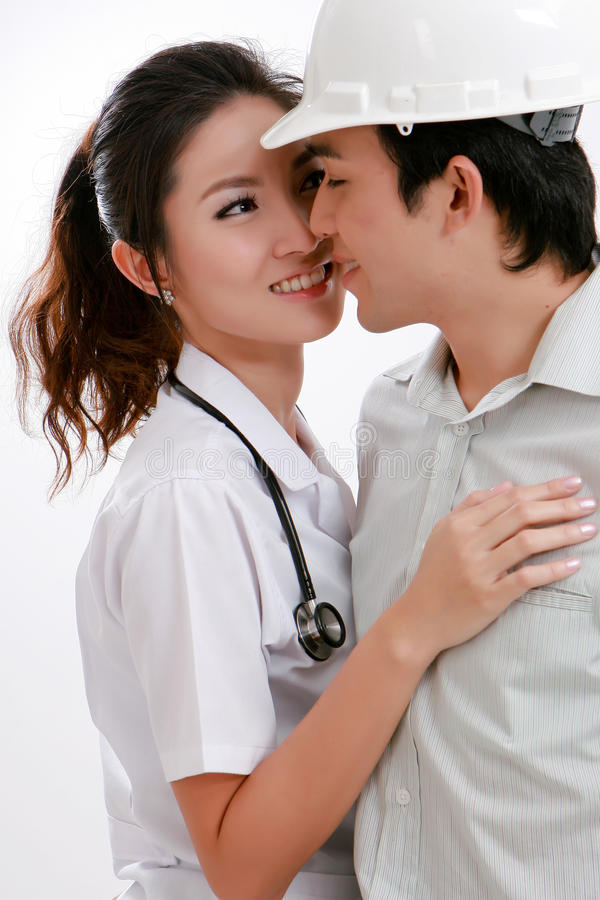 Download Young Physician Lady And Engineer Smiling Toget Stock Photo - Image of beauty, couple: 20855196