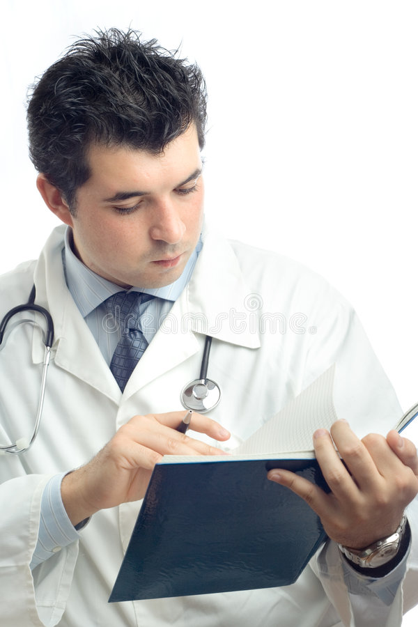 Download Young Physician Writing Down Notes In A Notebook Stock Image - Image: 1422083